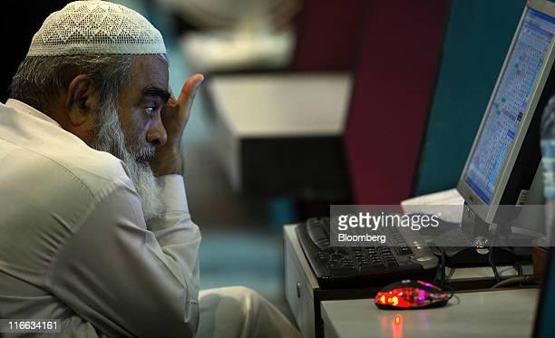 A trader works at the Karachi Stock Exchange in Karachi Pakistan on Thursday June 16 2011 Karachi Stock Exchange asked Pakistan's tax agency to amend...