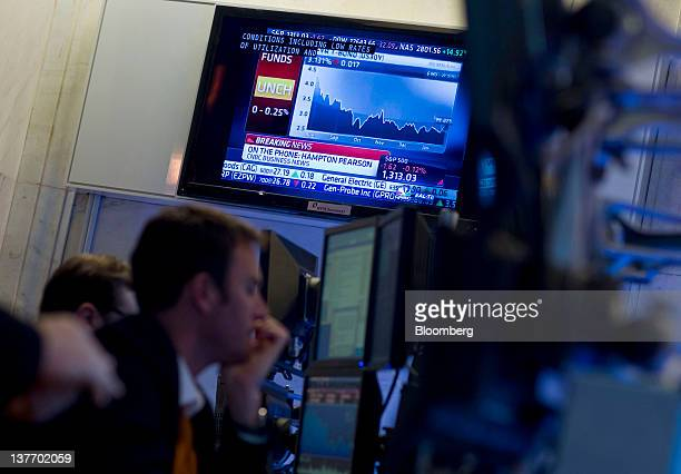 A trader works during the US Federal Reserve Federal Open Market Committee rate decision on the floor of the New York Stock Exchange in New York US...