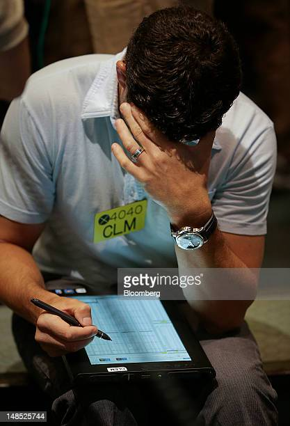 A trader works in the energy options pit at the New York Mercantile Exchange in New York US on Wednesday July 18 2012 Gasoline rose and heating oil...