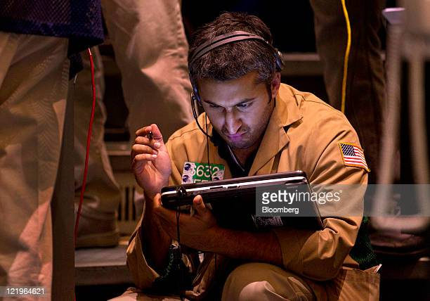 A trader works in the gold and silver options pit at the New York Mercantile Exchange in New York US on Wednesday Aug 24 2011 Gold plunged in New...
