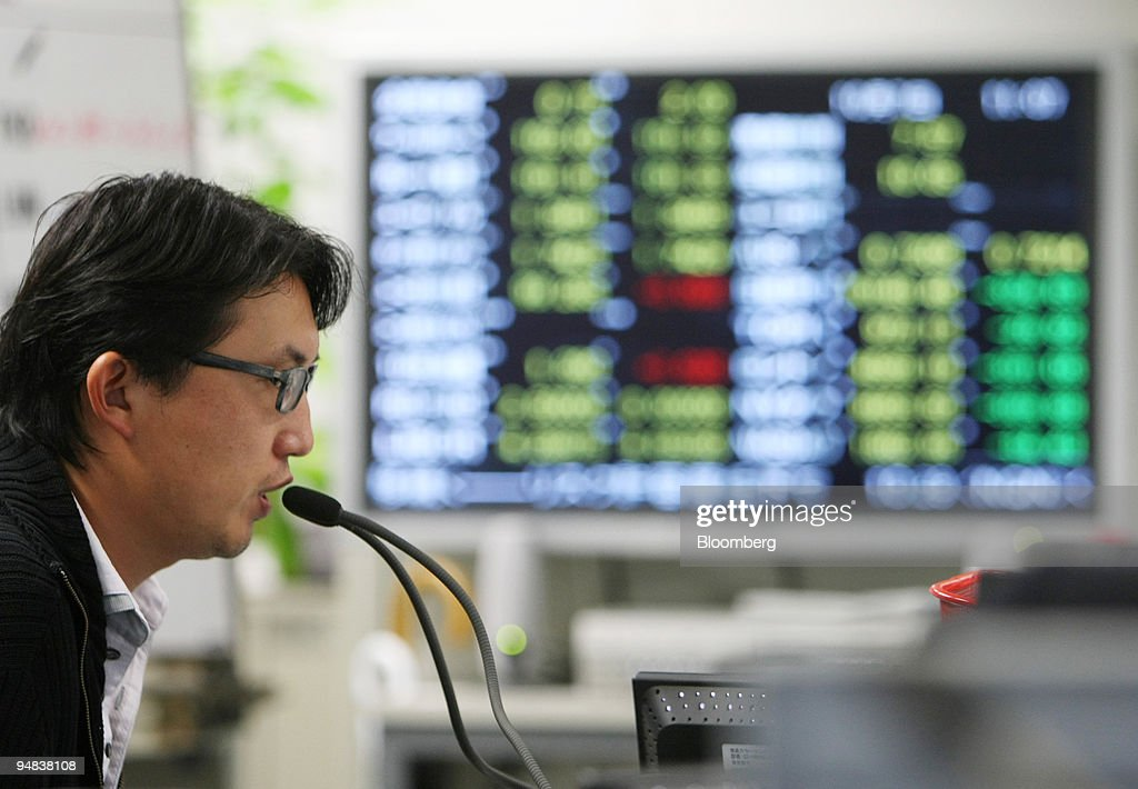A Trader Works In The Trading Room Of Foreign Exchange Brokerage Tokyo An