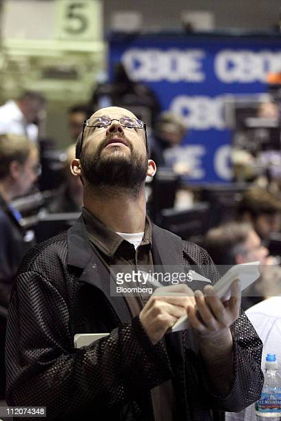 A trader works in the Volatility Index Options pit on the floor of the Chicago Board Options Exchange in Chicago Illinois US on Tuesday April 12 2011...