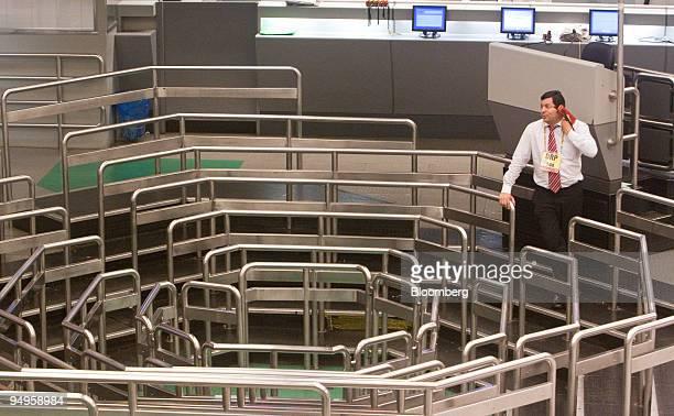 A trader works on an almost empty floor at the Brazilian Bolsa de Mercadorias e Futuros or Brazilian Mercantile and Futures Exchange in Sao Paulo...