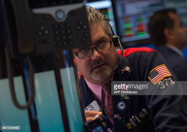 A trader works on the floor at the closing bell of the Dow Industrial Average at the New York Stock Exchange on September 14 2017 in New York The Dow...