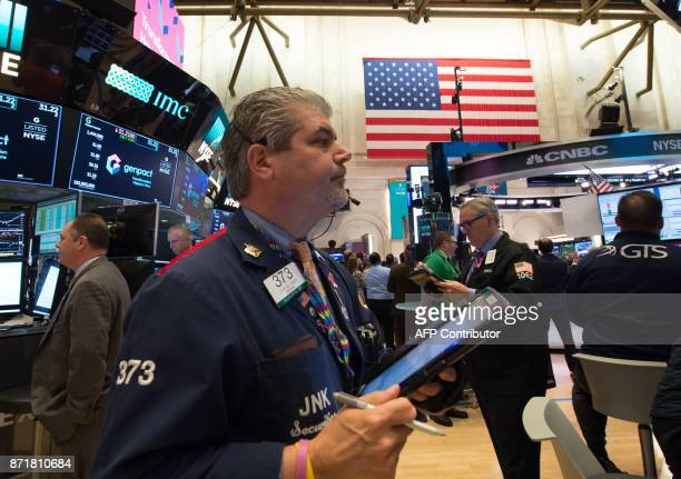 A trader works on the floor at the closing bell of the Dow Industrial Average at the New York Stock Exchange on November 8 2017 in New York Wall...