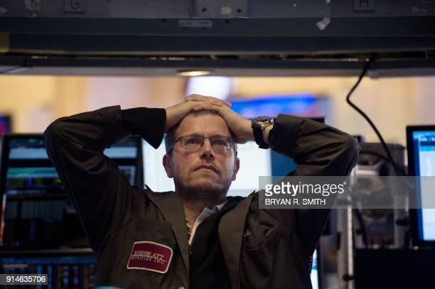 TOPSHOT A trader works on the floor at the closing bell of the Dow Industrial Average at the New York Stock Exchange on February 5 2018 in New York...