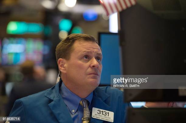 A trader works on the floor at the closing bell of the Dow Industrial Average at the New York Stock Exchange on February 5 2018 in New York Wall...