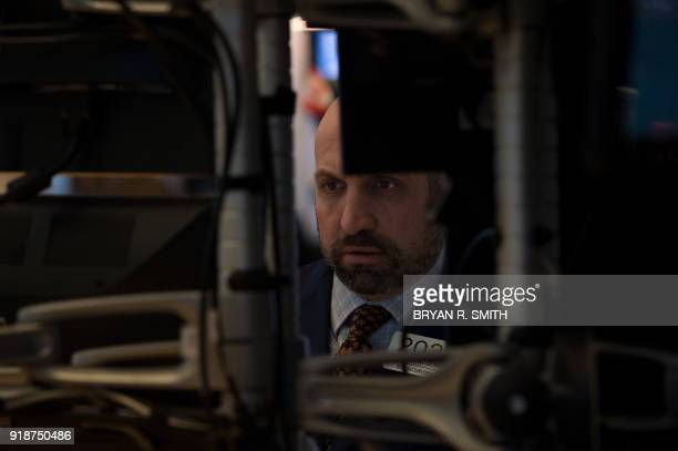 A trader works on the floor at the closing bell of the Dow Industrial Average at the New York Stock Exchange on February 15 2018 in New York Wall...