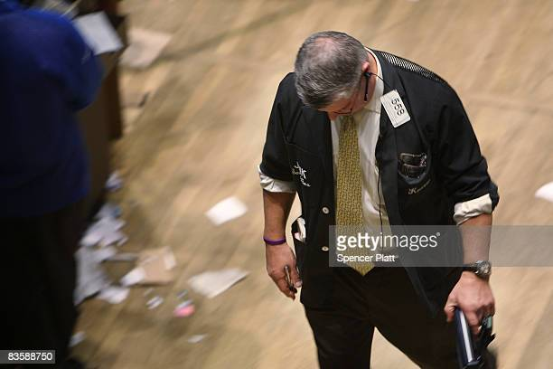 A trader works on the floor during the closing minutes of trading at the New York Stock Exchange November 6 2008 in New York City Worries about the...