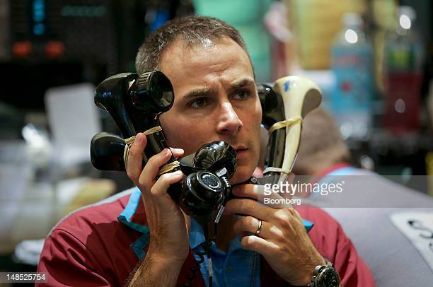 A trader works on the floor of the New York Mercantile Exchange in New York US on Wednesday July 18 2012 US stocks rose for a second day as...