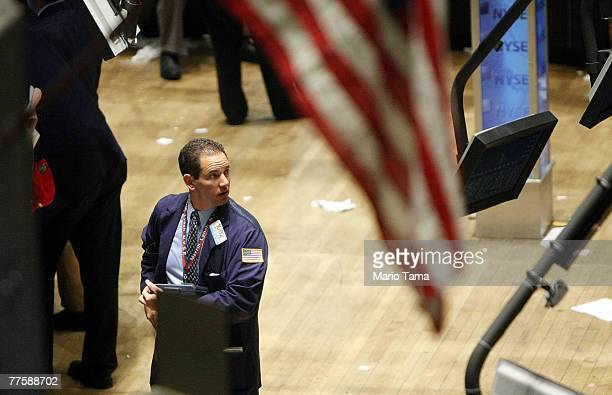 A trader works on the floor of the New York Stock Exchange after the Fed interest rate cut was announced October 31 2007 in New York City The Federal...