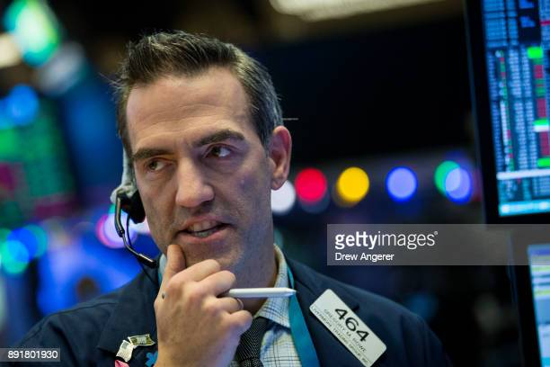 A trader works on the floor of the New York Stock Exchange ahead of the closing bell December 13 2017 in New York City The Dow Jones industrial...