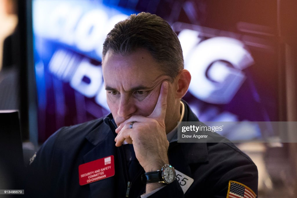 A trader works on the floor of the New York Stock Exchange (NYSE) at the closing bell, February 2, 2018 in New York City. The Dow dropped 250 points at the open on Friday morning. The Dow plunged over 660 points on Friday, marking its biggest one day plunge since June 2016 following the Brexit vote.