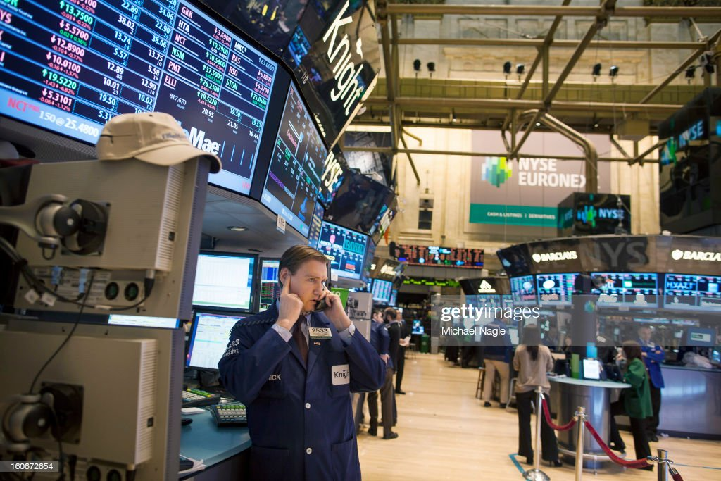 A trader works on the floor of the New York Stock Exchange at the end of the trading day on February 4, 2013 in New York City. Stocks dropped sharply February 4, to 13,880 after the Dow closes last week above 14000.