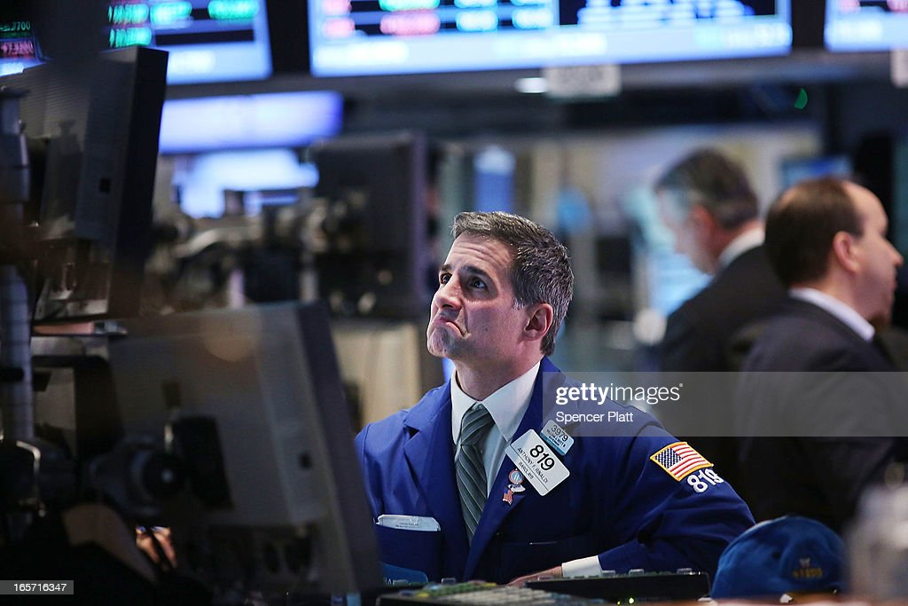 A trader works on the floor of the New York stock Exchange at the end of the trading day on April 5, 2013 in New York City. Following news of a disappointing jobs report, U.S. stocks fell Friday.The Dow Jones industrial average lost more than 40 points, or 0.3%, while the S&P 500 fell 0.4%.
