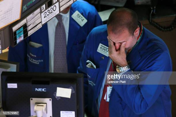 A trader works on the floor of the New York Stock Exchange during late day trading on June 29 2010 in New York City Following new signs of a...
