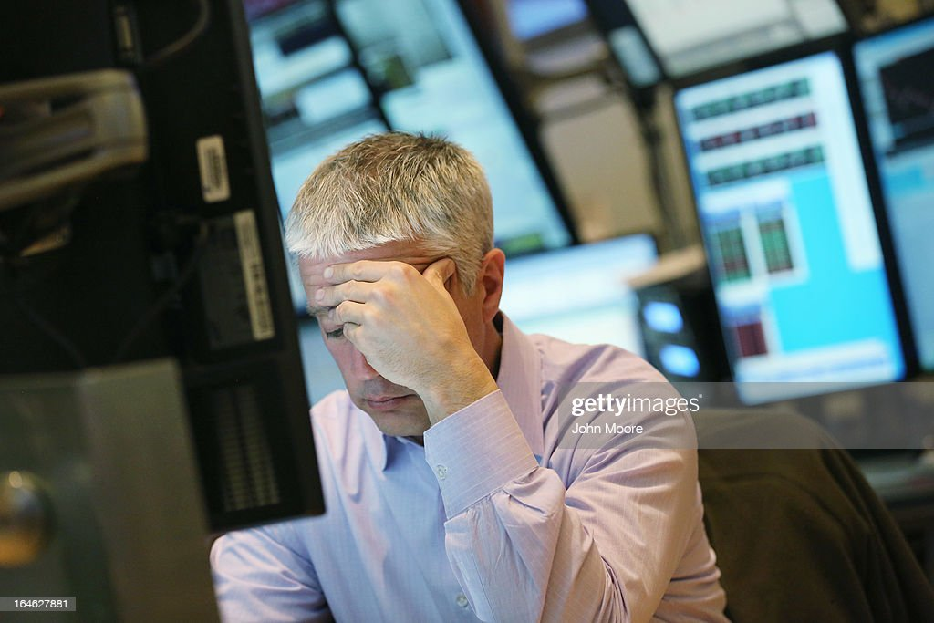 A trader works on the floor of the New York Stock Exchange during late tradingon March 25, 2013 in New York City. The Dow Jones Industrial Average closed down 64 points amid renewed worries about Cyprus.