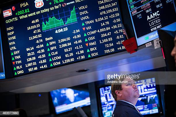A trader works on the floor of the New York Stock Exchange during the afternoon of February 13 2015 in New York City The Dow Jones Industrial Average...