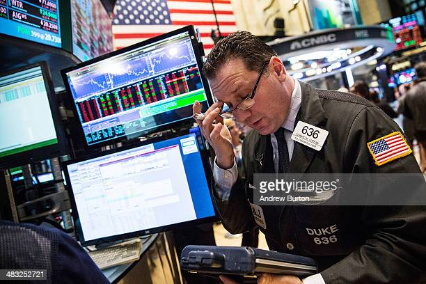 A trader works on the floor of the New York Stock Exchange during the afternoon of April 7 2014 in New York City The Dow fell more than 160 points by...