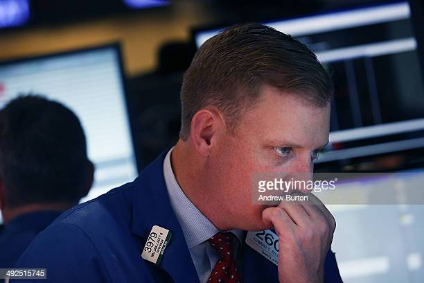 A trader works on the floor of the New York Stock Exchange during the afternoon of May 20 2014 in New York City Retailers reported low earnings today...