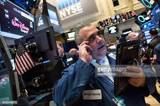 A trader works on the floor of the New York Stock Exchange during the morning of January 4 2016 in New York City Today marks the first day of trading...