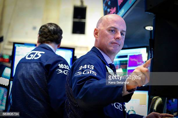 A trader works on the floor of the New York Stock Exchange during the evening of July 27 2016 in New York City The dollar fell Wednesday as the US...