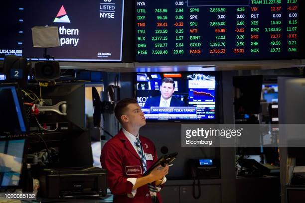 Traders work on the floor of the New York Stock Exchange in New York US on Monday Aug 20 2018 US stocks and Treasuries rose as traders held onto...