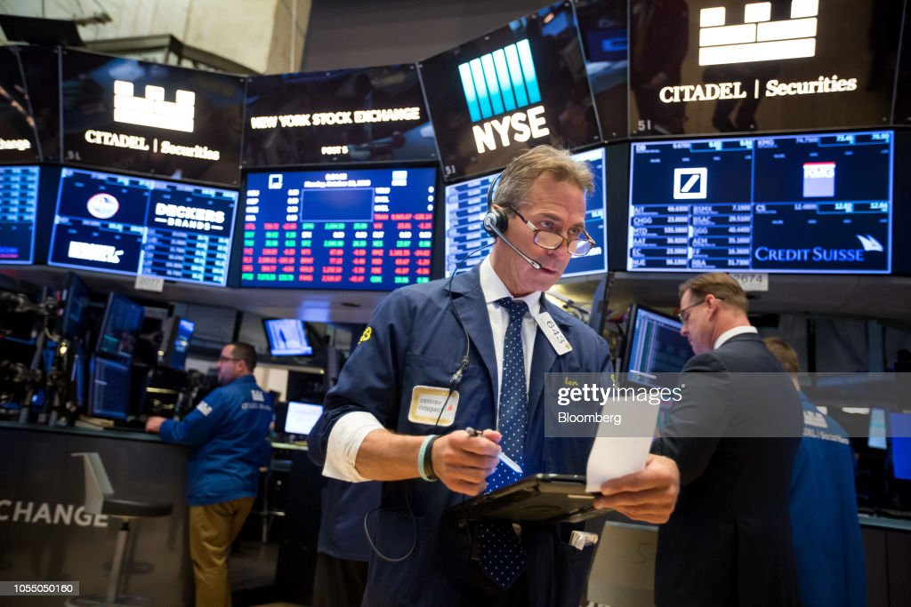 A trader works on the floor of the New York Stock Exchange in New