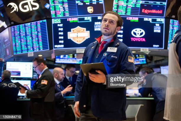 Trader works on the floor of the New York Stock Exchange in New York, U.S., on Wednesday, Feb. 26, 2020. U.S. Equities swung between gains and losses...