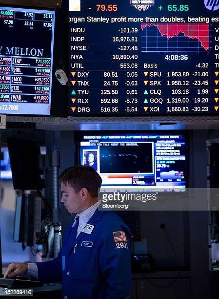 A trader works on the floor of the New York Stock Exchange in New York US on Thursday July 17 2014 US stocks fell while Treasuries rallied with gold...
