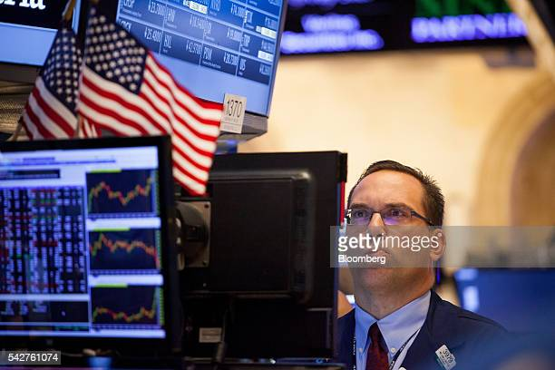 A trader works on the floor of the New York Stock Exchange in New York US on Friday June 24 2016 US stocks tumbled joining a worldwide selloff with...