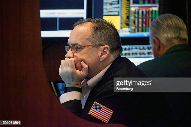 A trader works on the floor of the New York Stock Exchange in New York US on Friday Aug 19 2016 US stocks slipped for the first time in three days...