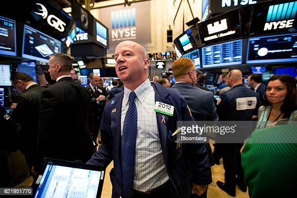A trader works on the floor of the New York Stock Exchange in New York US on Wednesday Nov 9 2016 US stocks fluctuated in volatile trading in the...