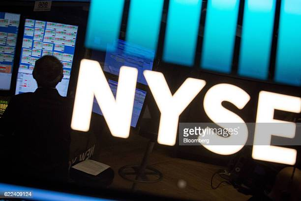 A trader works on the floor of the New York Stock Exchange in New York US on Friday Nov 11 2016 US stocks fluctuated in whipsaw trading with the Dow...