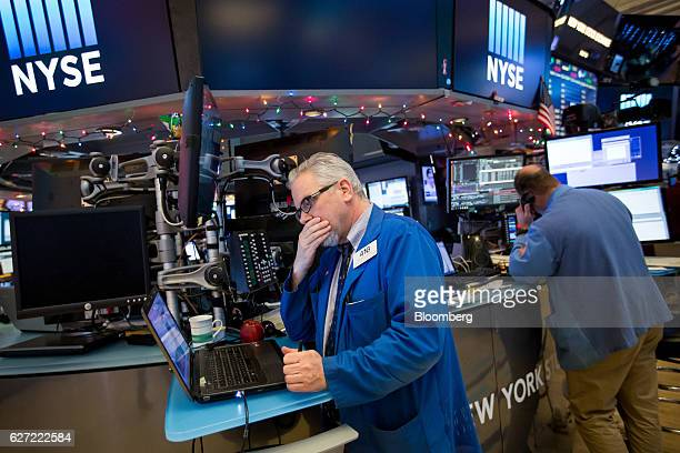 A trader works on the floor of the New York Stock Exchange in New York US on Friday Dec 2 2016 US stocks fluctuated near a twoweek low after the...