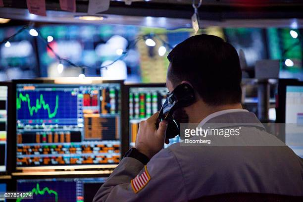 A trader works on the floor of the New York Stock Exchange in New York US on Monday Dec 5 2016 US stocks climbed reversing a brief dip in early...