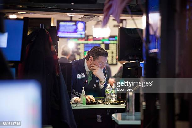 A trader works on the floor of the New York Stock Exchange in New York US on Friday Jan 13 2017 US stocks rose toward a record Treasuries fell and...