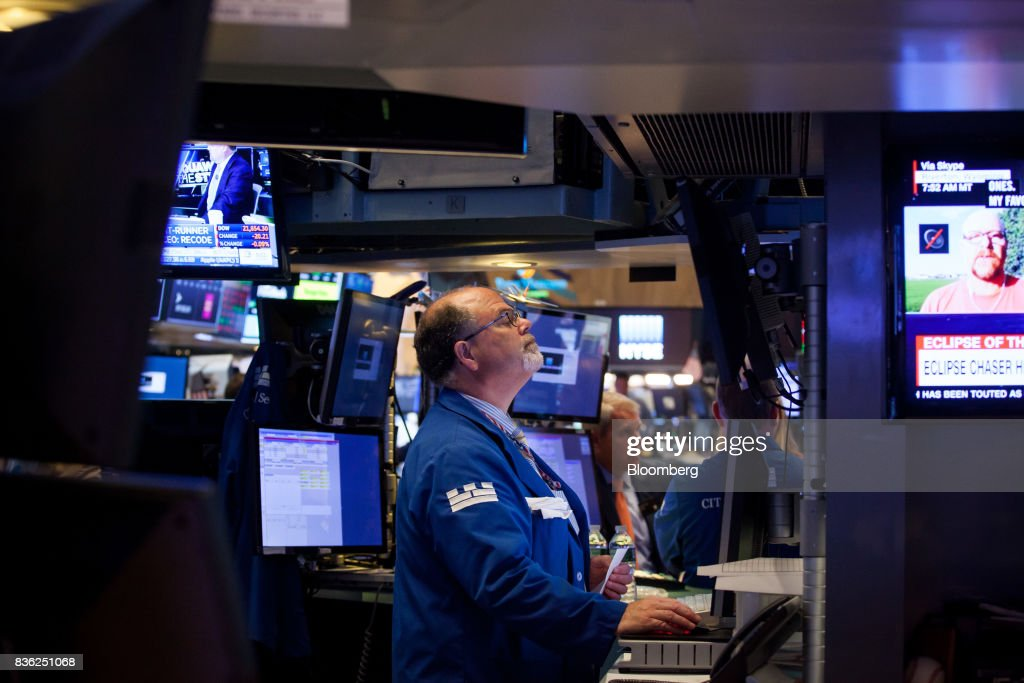A trader works on the floor of the New York Stock Exchange (NYSE) in New York, U.S., on Monday, Aug. 21, 2017. U.S. stocks fluctuated after erasing early losses, while the dollar edged lower amidgrowing uneaseabout persistent low inflation and as investors await central bank speeches at Jackson Hole. Photographer: Michael Nagle/Bloomberg via Getty Images