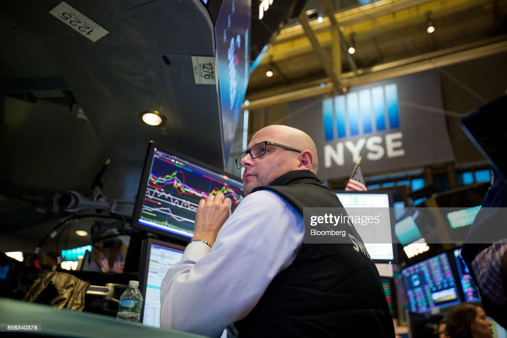 A trader works on the floor of the New York Stock Exchange (NYSE) in New York, U.S., on Friday, Oct. 6, 2017. U.S. stocks edged lower while the dollar rose with Treasury yields after American payrolls contracted for the first time since 2010 and hourly wages spiked higher. Photographer: Michael Nagle/Bloomberg via Getty Images