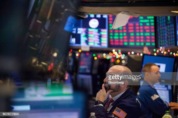 A trader works on the floor of the New York Stock Exchange in New York US on Monday Jan 8 2018 US stocks were mixed with the SP 500 Index on track...