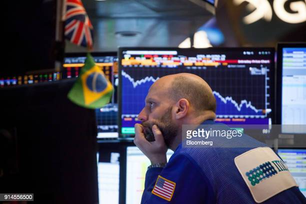 A trader works on the floor of the New York Stock Exchange in New York US on Monday Feb 5 2018 US stocks remained down after recovering from steeper...