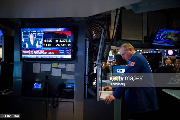 A trader works on the floor of the New York Stock Exchange in New York US on Monday Feb 5 2018 US stocks plunged sending the Dow Jones Industrial...