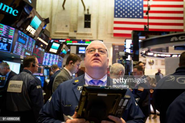 A trader works on the floor of the New York Stock Exchange in New York US on Tuesday Feb 6 2018 US equity indexes climbed higher after a rocky start...