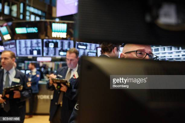 A trader works on the floor of the New York Stock Exchange in New York US on Friday Feb 23 2018 US stocks rose with Treasuries and the dollar slipped...