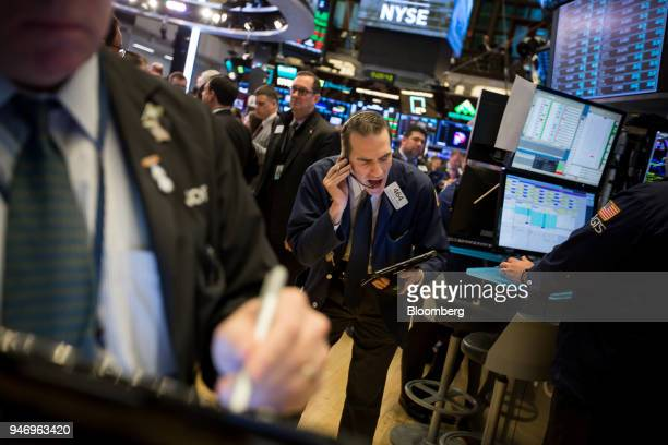 A trader works on the floor of the New York Stock Exchange in New York US on Monday April 16 2018 US stocks rallied and Treasuries slid as...