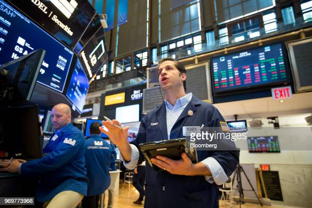 Trader works on the floor of the New York Stock Exchange in New York, U.S., on Friday, June 8, 2018. Most U.S.Equitiesdrifted lower as global...
