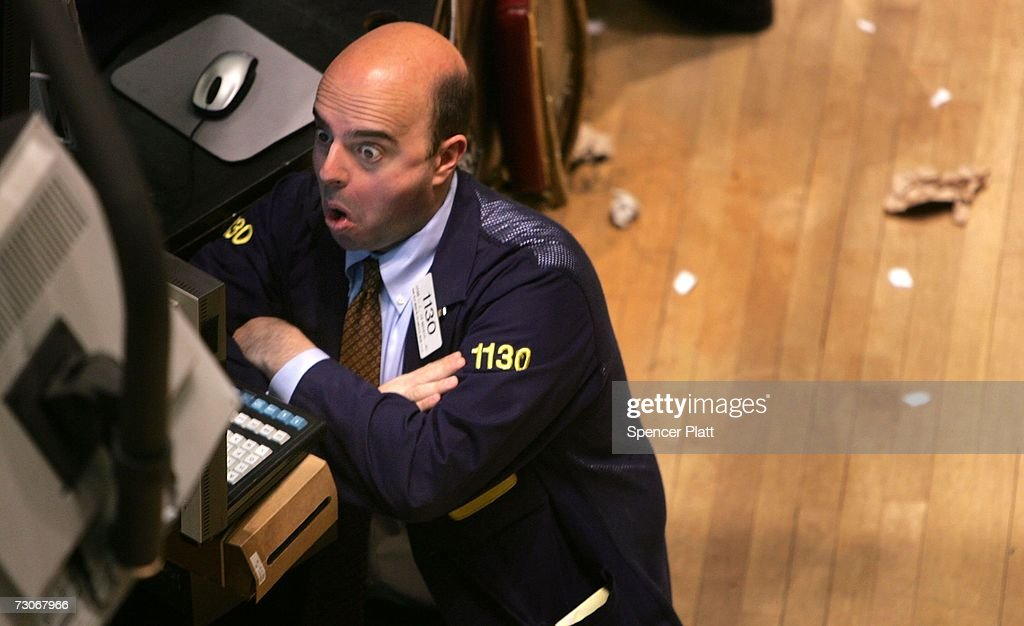 A trader works on the floor of the New York Stock Exchange (NYSE) in the financial district January 22, 2007 in New York City. In a study commissioned by New York City Mayor Michael Bloomberg and U.S. Sen. Charles Schumer (D-NY), it was determined that New York could lose its place as the financial capital of the world in as little as 10 years.