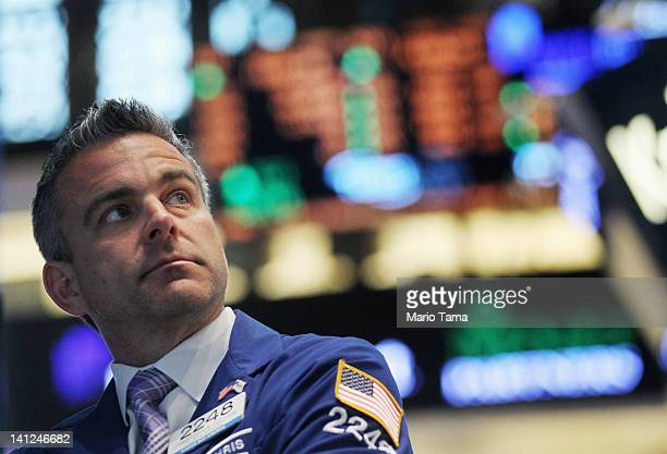 A trader works on the floor of the New York Stock Exchange minutes after the Federal Reserve announced it would leave interest rates unchanged on...