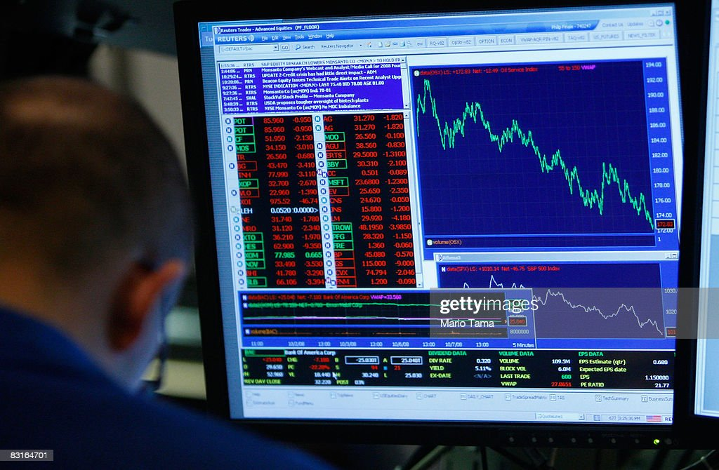 Dow Plunges Despite Fed Buyout Plan for Debt : News Photo