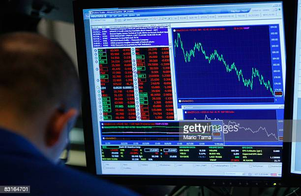 A trader works on the floor of the New York Stock Exchange October 7 2008 in New York City Despite a government debt buyout plan the Dow continued to...